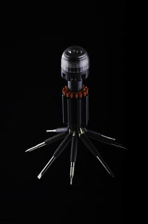 Multifunctional tool isolated on black background.