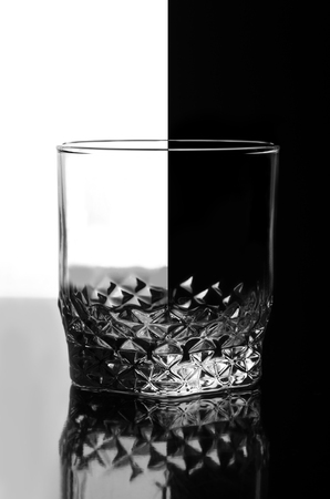 Wine glass on a black and white background, abstract. Stock Photo