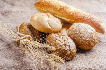 An assortment of lush pastries and spikelets on burlap.