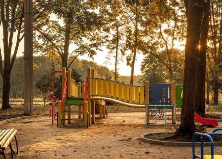 Empty playground at sunrise in autumn scenery Stockfoto
