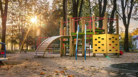 Empty playground at sunrise in autumn scenery 版權商用圖片