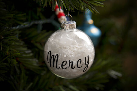Homemade Christmas Ornament with the word Mercy on it.