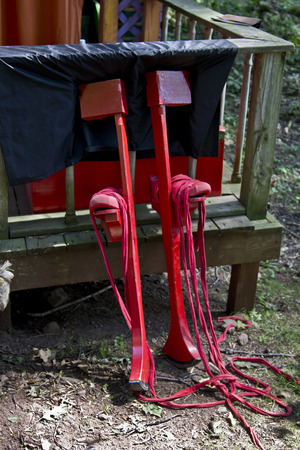 A pair of stilts leaning against a porch at the Sterling Renaissance Festival. Imagens