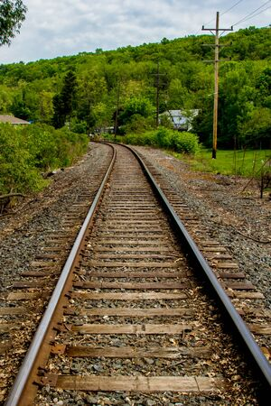 ballast: Railroad tracks disappearing around a bend in the distance Stock Photo