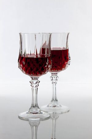 with two: Two partially filled wine glasses Stock Photo