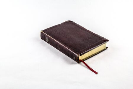 beginnings: Old worn Bible on White Background Stock Photo