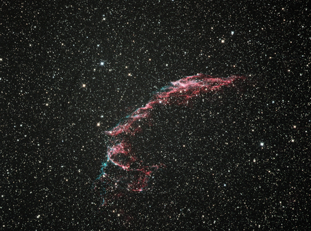NGC6992 The Veil Nebula is a cloud of heated and ionized gas and dust in the constellation Cygnus. It constitutes the visible portions of the Cygnus Loop radio source W78, or Sharpless 103, a large but relatively faint supernova remnant. The source supern