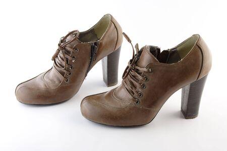 zip tie: Brown female boots Stock Photo