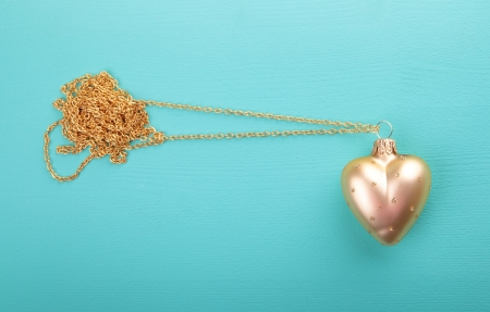Gold heart with gold chain  photo