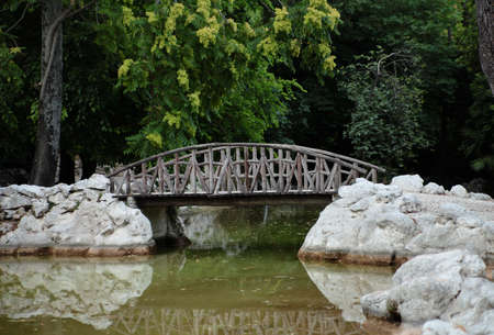 Old wooden bridge in the park.Greece,Athens. photo