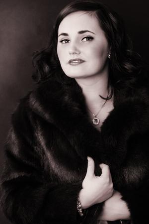 portrait of a beautiful woman wearing fur photo