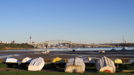 upturned: Upturned boats at low tide by Auckland Harbour Bridge