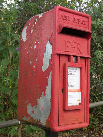 red post box: Old red post box in Elstead, Surrey UK Stock Photo