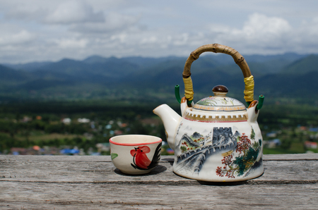 chinese teapot: chinese teapot and teacup at mountain viewpoint