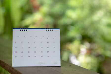 Desktop Calendar 2019 place on wooden office desk.Calender for Planner to make timetable,agenda appointment,organization,management each date,month and year on table.Calendar Background Concept. Stockfoto - 134717689