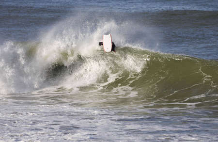 good bodyboarder on a powerful wave in Anglet ( France) photo