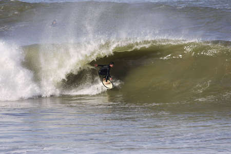 surfeur on a powerful wave photo