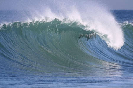 breaking up: powerful wave breaking near the shore Stock Photo