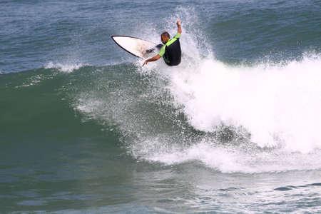 surfer riding a wave photo