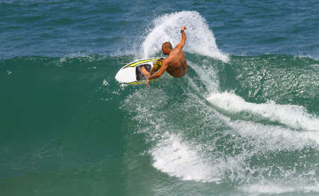 good surfer in action photo
