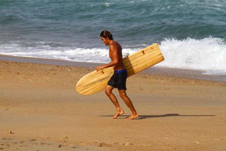 balsa: surfer walking on the beach Stock Photo