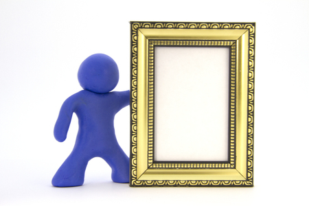 Blue plasticine character and gold photo frame. Isolated over white background Stock Photo