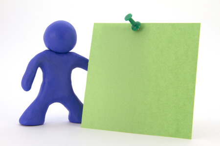 Blue plasticine character and green sticker. Stationery. Isolated over white background Stock Photo