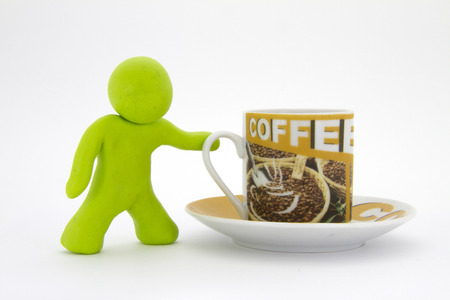 Lime green plasticine character and cup of coffee. Coffee set. Isolated over white background