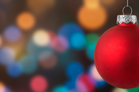Christmas red bauble over a bokeh background