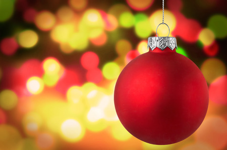 背景のボケ味をクリスマス赤安物の宝石