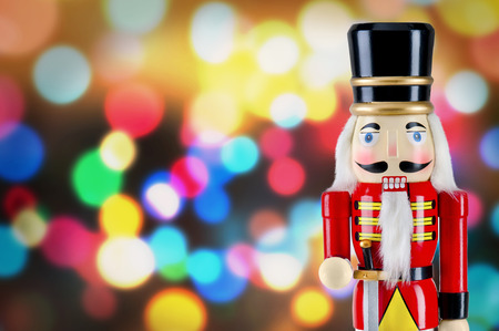 the nutcracker: Soldier nutcracker statue standing in front of Christmas lights