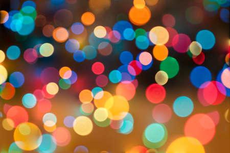 クリスマス ライトの背景の円形のボケ味を抽象化します。