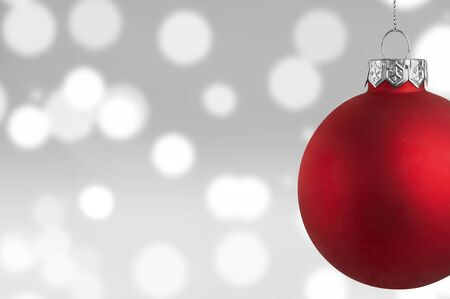 glass ornament: Red Christmas bauble over a bokeh background Stock Photo