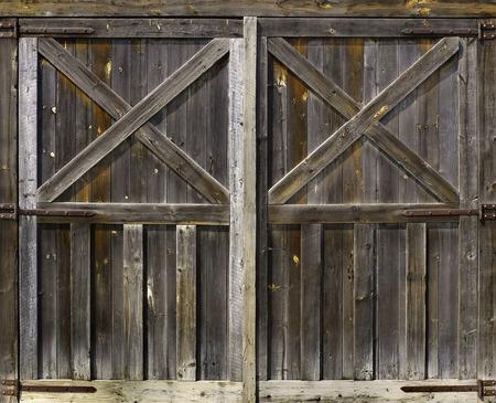 Rustic weathered fienile porta sfondo con nodi e fori di chiodo