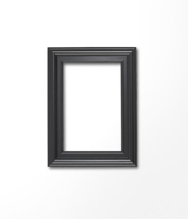 白のギャラリーの壁に空白のフレーム 写真素材