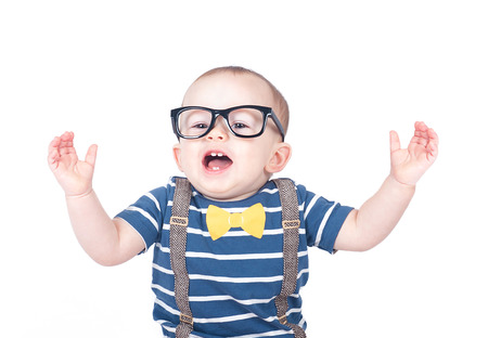 Smart baby wearing glasses isolated on a white background