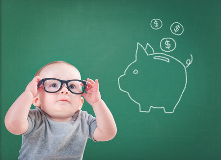 baby with glasses thinks about saving for the future 스톡 콘텐츠