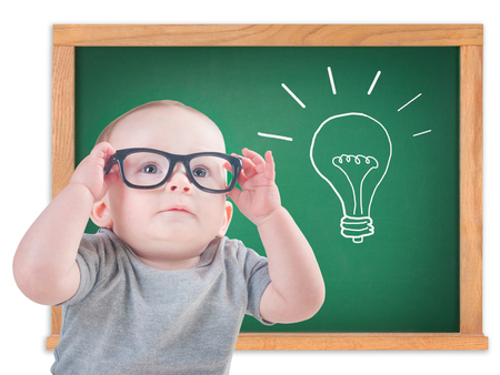 Smart baby with glasses with an idea