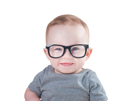 Baby with glasses isolated on a white background