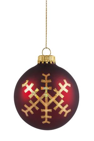 Kerstmisbal van de sneeuwvlok het hangen op koord, op wit wordt geïsoleerd dat Stockfoto