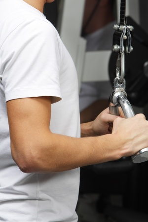 Closeup foto of exercising on training simulator in fitness club Stock Photo - 8738293