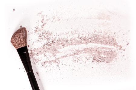 Makeup brush on white background, with traces of powder and blush on it. A horizontal template for a makeup artists business card or flyer design, with plenty of copyspace