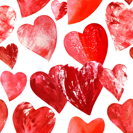 A seamless pattern of many different print stamped mixed media red hearts on white background