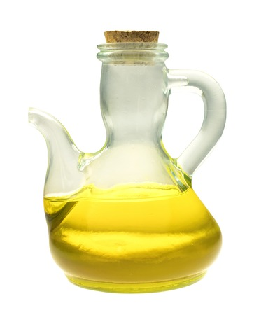 extra virgin olive oil: A side view of a shiny bottle of extra virgin olive oil, isolated on white background Stock Photo
