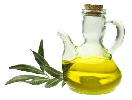 extra virgin olive oil: A side view of a shiny bottle of extra virgin olive oil with a branch, isolated on white background Stock Photo