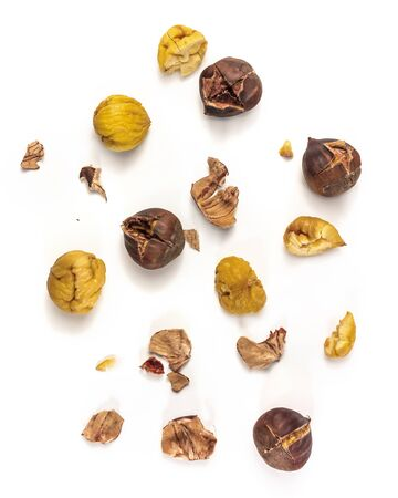 A photo of peeled and unpeeled roasted chestnuts, shot from above on white background Stockfoto
