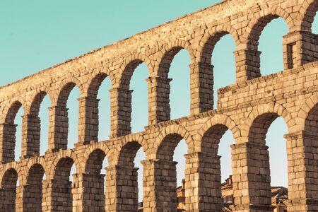Photo of ancient Roman aqueduct in Segovia, Spain Stock Photo