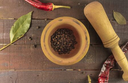candid: Mortar with peppercorns and pestle, candid photo
