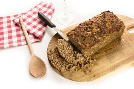 meatloaf: Freshly cooked and cut meatloaf with knife Stock Photo