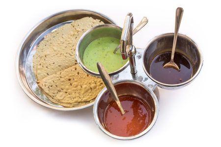 Indian bread served with traditional assortment of sauces Stock Photo